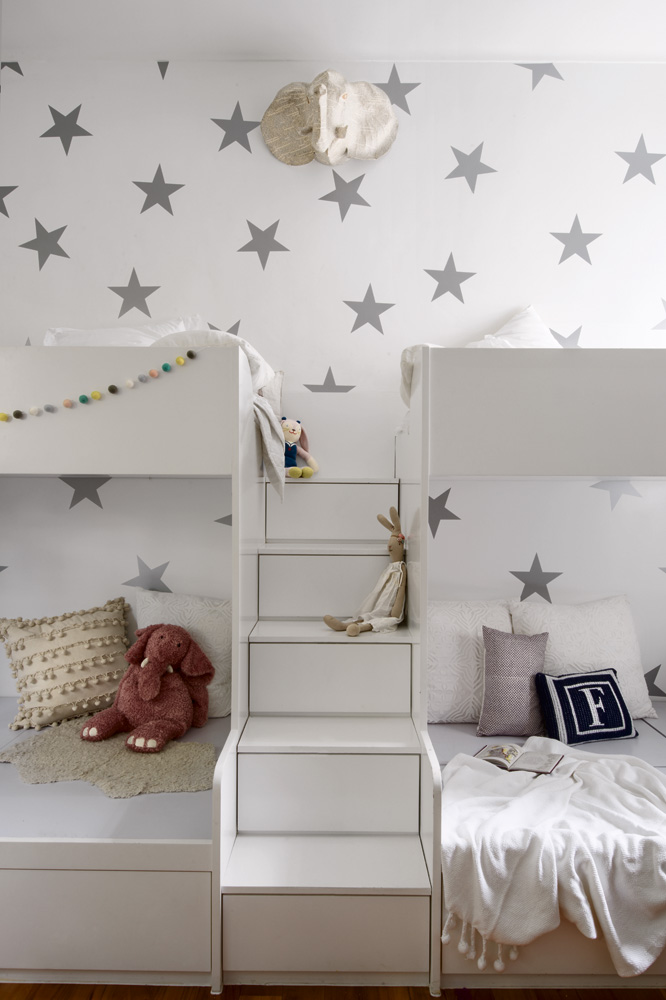 Starry wallpaper endows the children's bedroom with a sense of adventure.