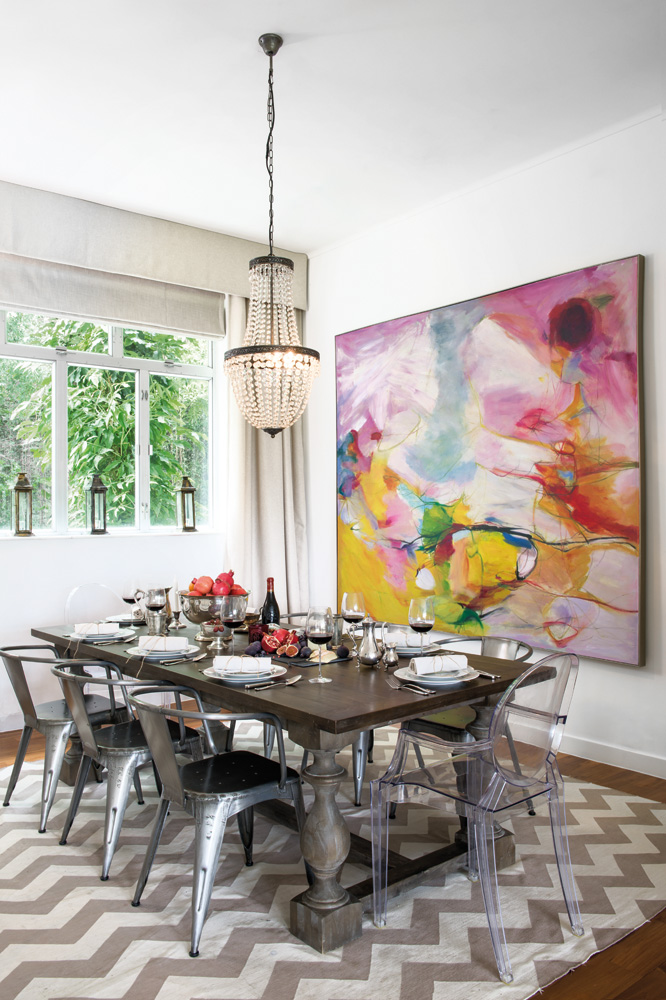 An arresting abstract bought in Dafen Art Village adds bright bursts of colour in the inviting dining area.