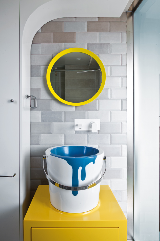 The space that makes the loudest statement is the bathroom, where a tin-paint-effect sink and mirror steal the scene.
