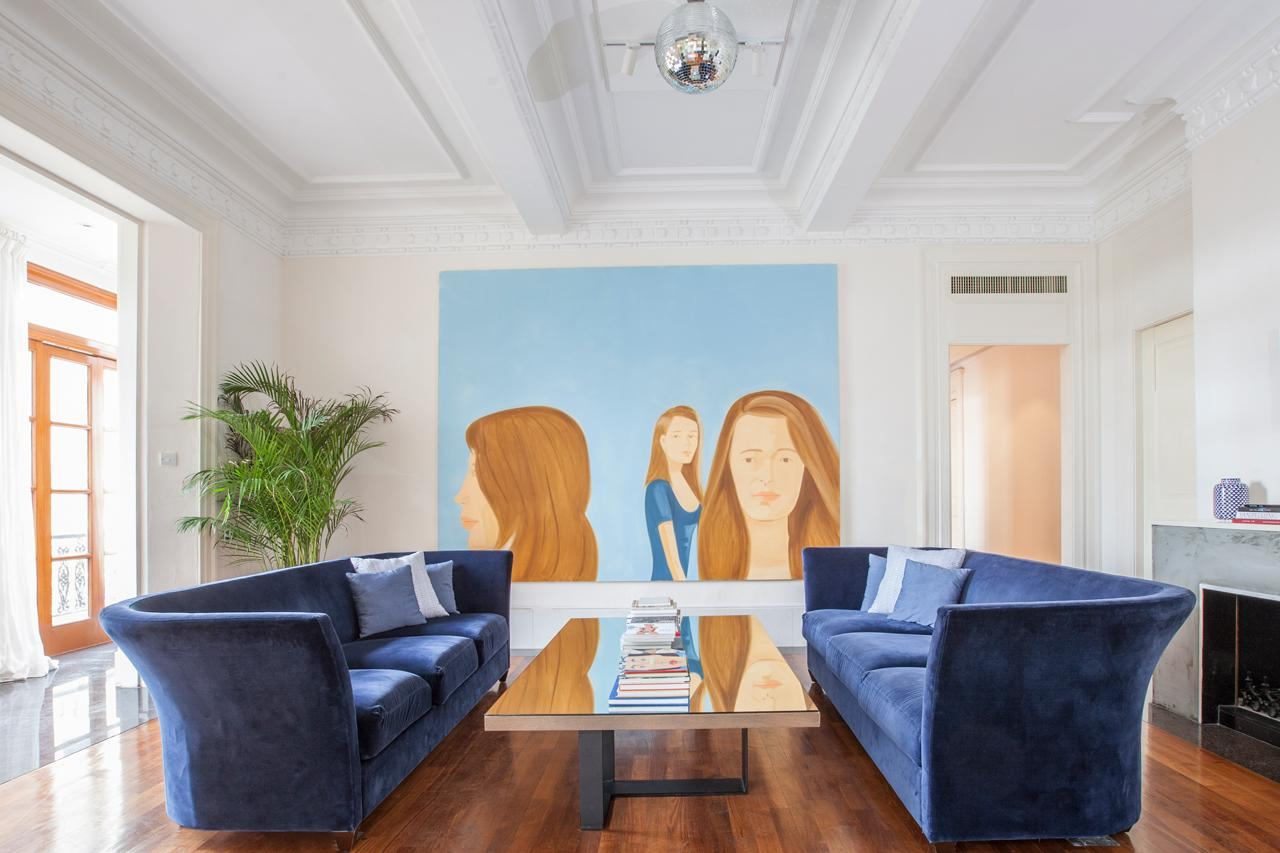 The living room features a large-scale Alex Katz work