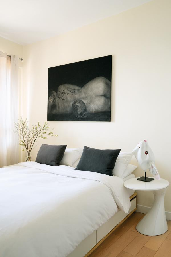 Lalie, by Christophe Bonacorsi, sits above the bed