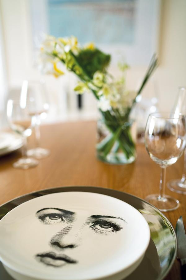 Dishes are by Fornasetti, available at Lane Crawford