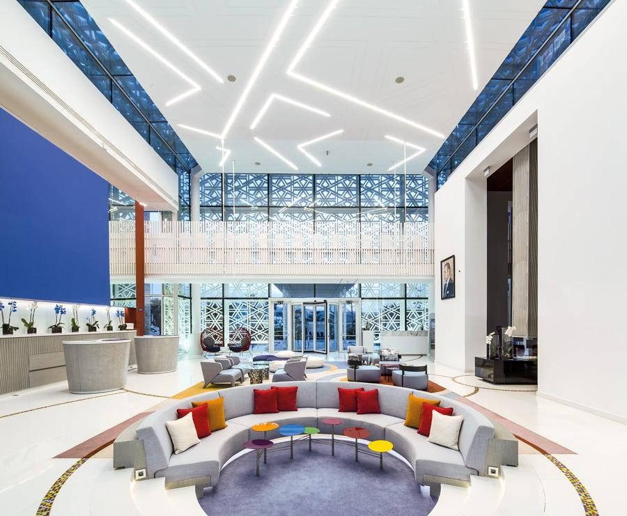 The double-height lobby boasts pops of colour, rich Moroccan blues, contemporary artworks and modern moucharaby screens