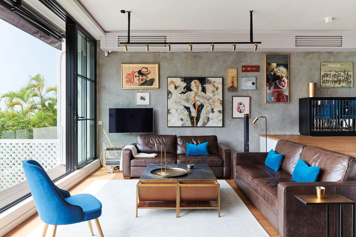The sofa is from Indigo Living; cushions are from Blanc des Voges