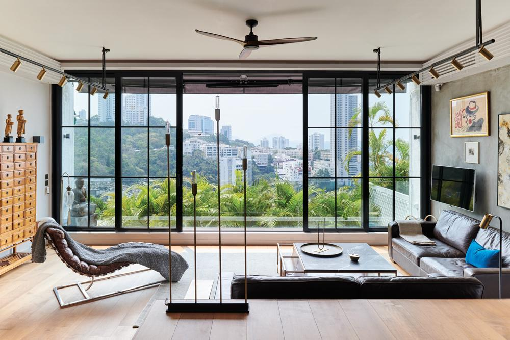 Floor to ceiling windows looks out to sweeping cityscape