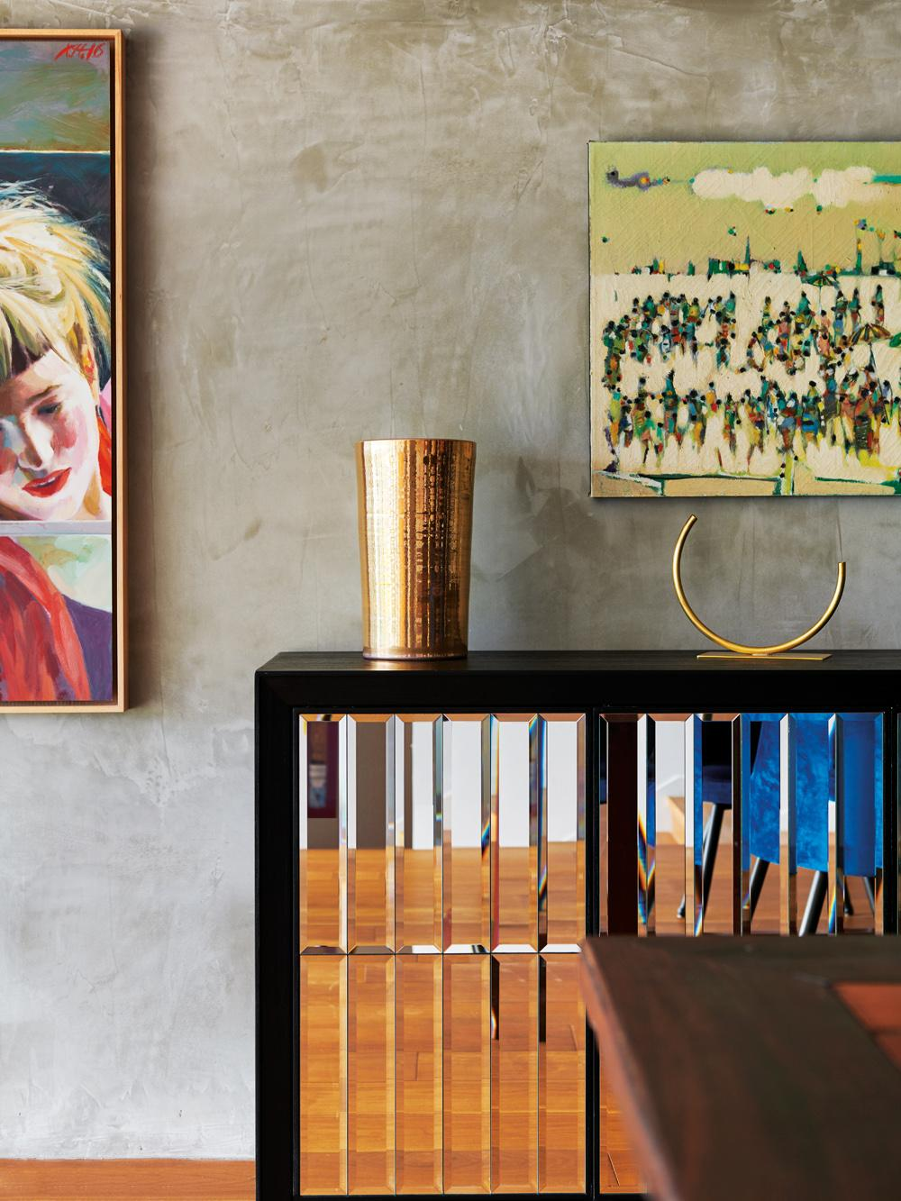 Vibrant artwork and golden accents are peppered throughout the home