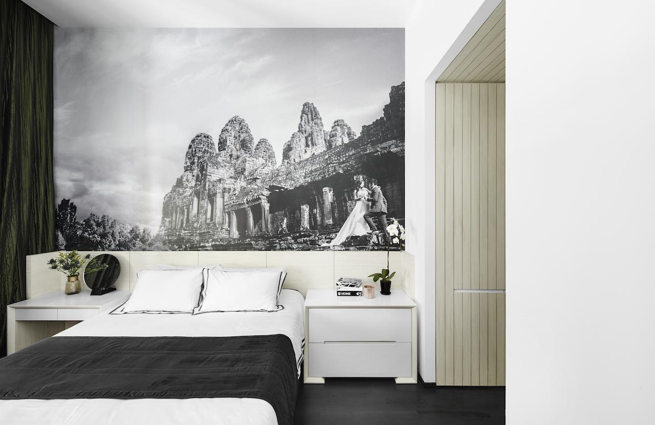 The large mural of the couple's wedding photo underlines the voluminous ceiling in the master bedroom
