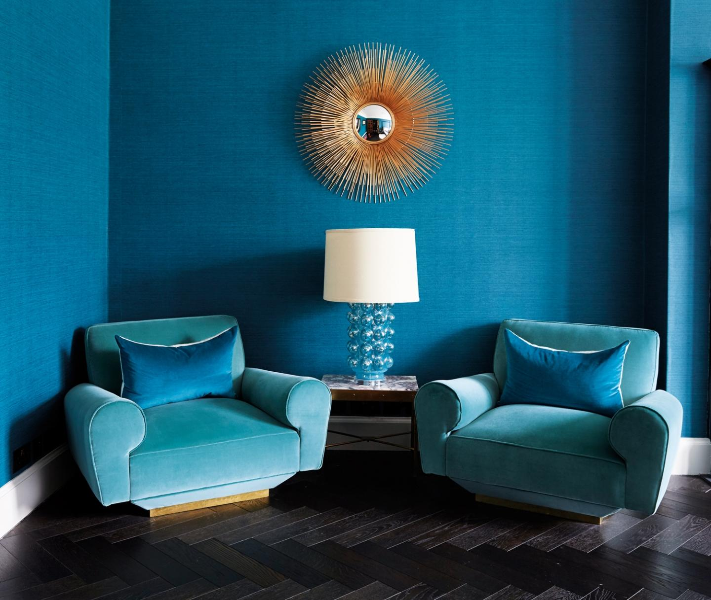 Shades of turquoise adorn a quaint reading area