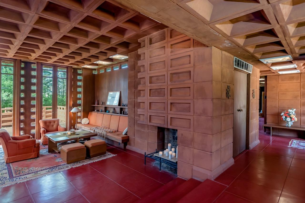 The furniture, also designed by Frank Lloyd Wright, is also included in the sale.