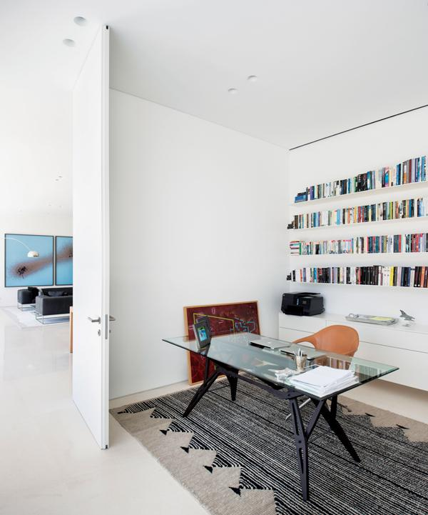 Pared back interiors adorn the library, which houses a careful collection of personal items