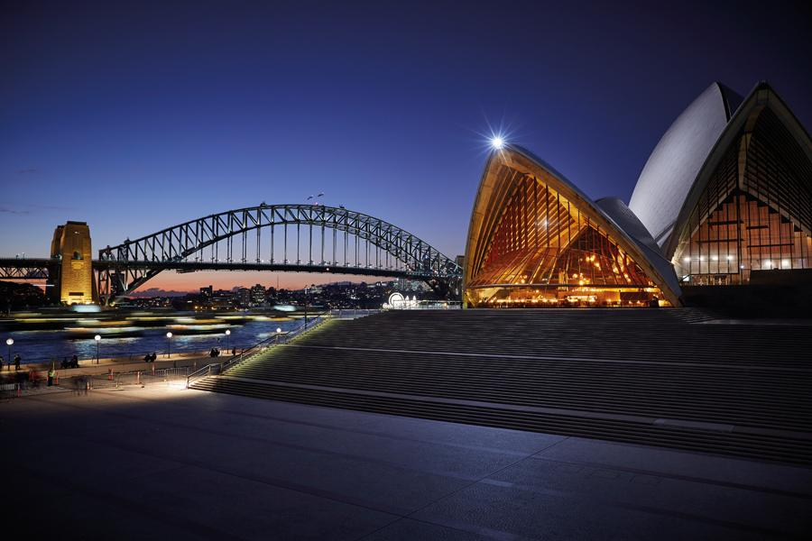 The restaurant is nestled within the iconic Sydney Opera House, looking the most dramatic and atmospheric at night
