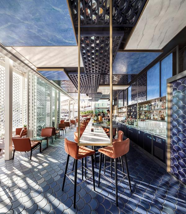 Blue tones and lattice work reflect the bar's oceanside location