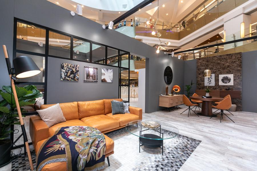 The living room is decorated with the Carlton sofa with resting unit, Madrid coffee table, Bermuda footstool, Lugano sideboard, Five chandelier, Outrigger floor lamp, Random rug