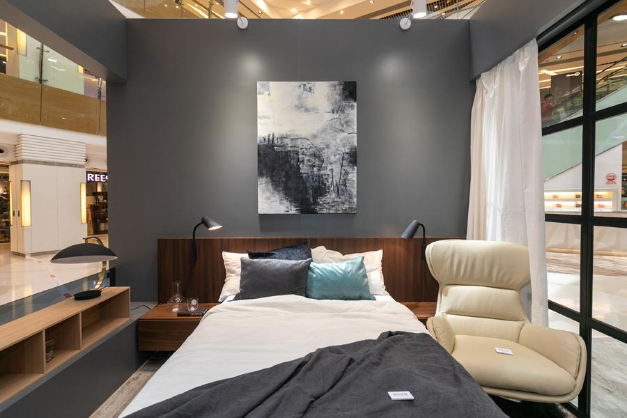 The bedroom is outfitted in the Reno chair, Lugano storage bed, Lugano night stand and Curious wall lamp