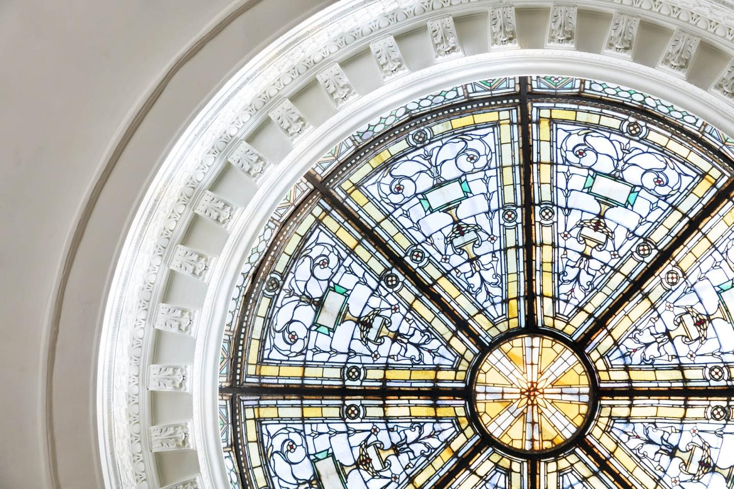 The stained glass domed ceiling