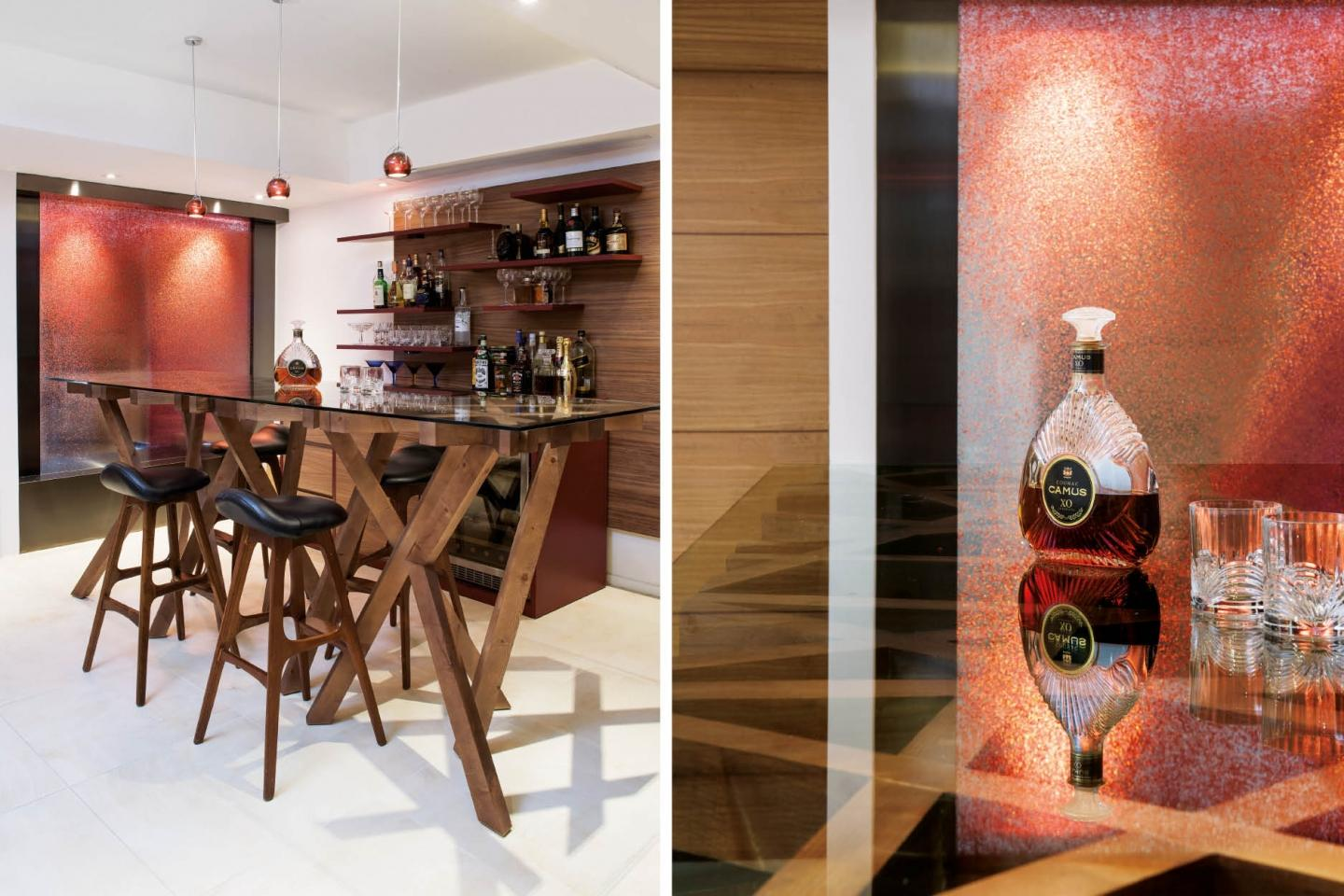 Shades of red and dark wood detailing endow the bar with the ambience of a contemporary gentleman
