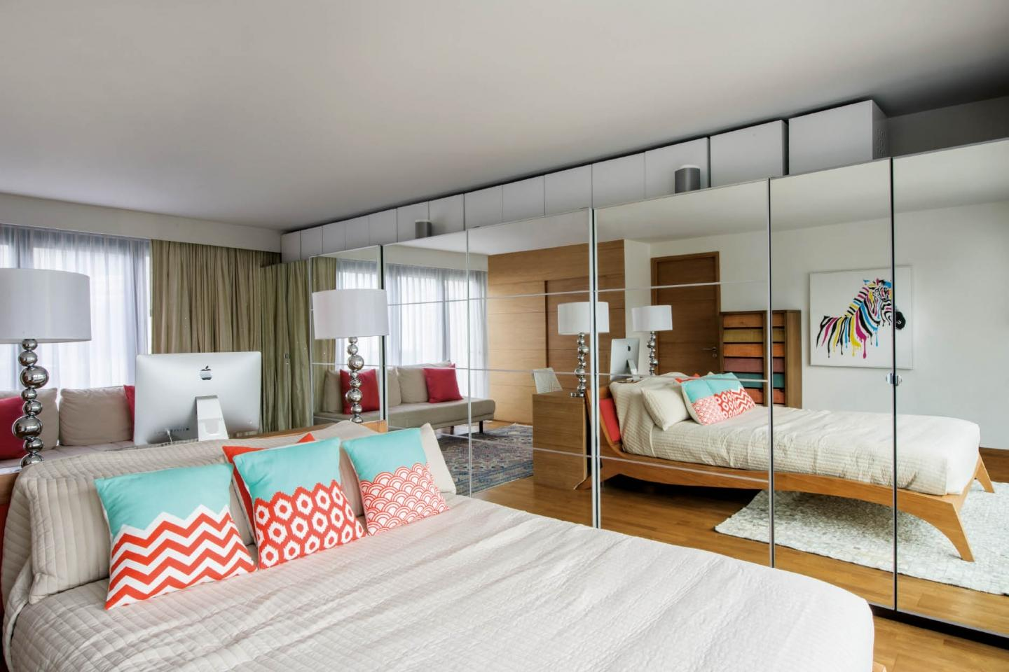 Mirrored storage gives the illusion of extra space and adds light to the guest bedroom
