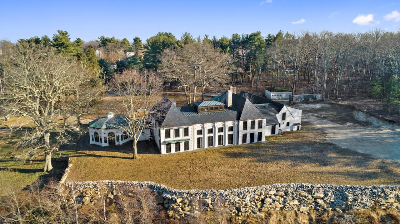 A 13,000-square-foot main house is surrounded by numerous guest houses and amenities