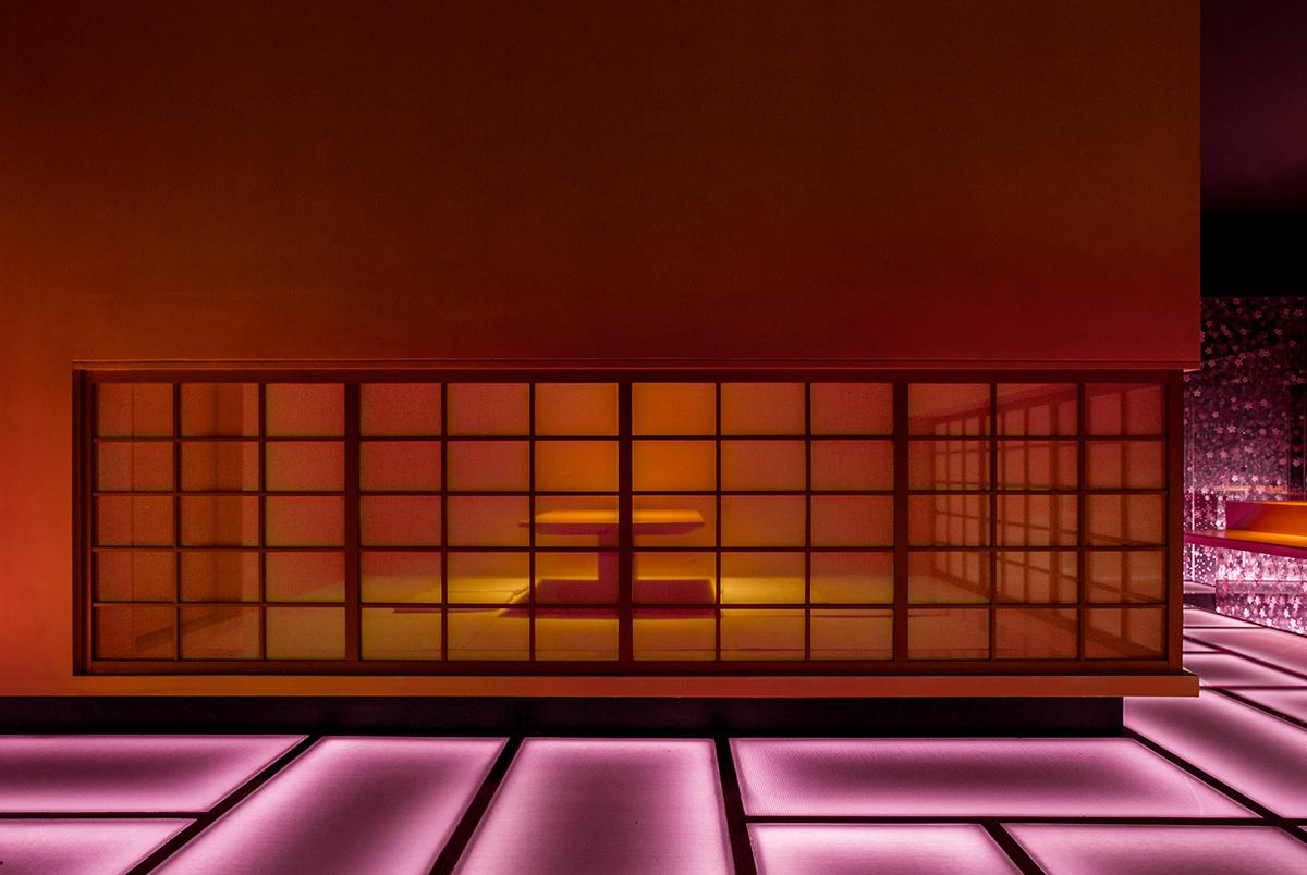 A closeup of the private dining room, in a contrasting amber glow. (Photo: Courtesy of Shanghai Hip-pop Design)