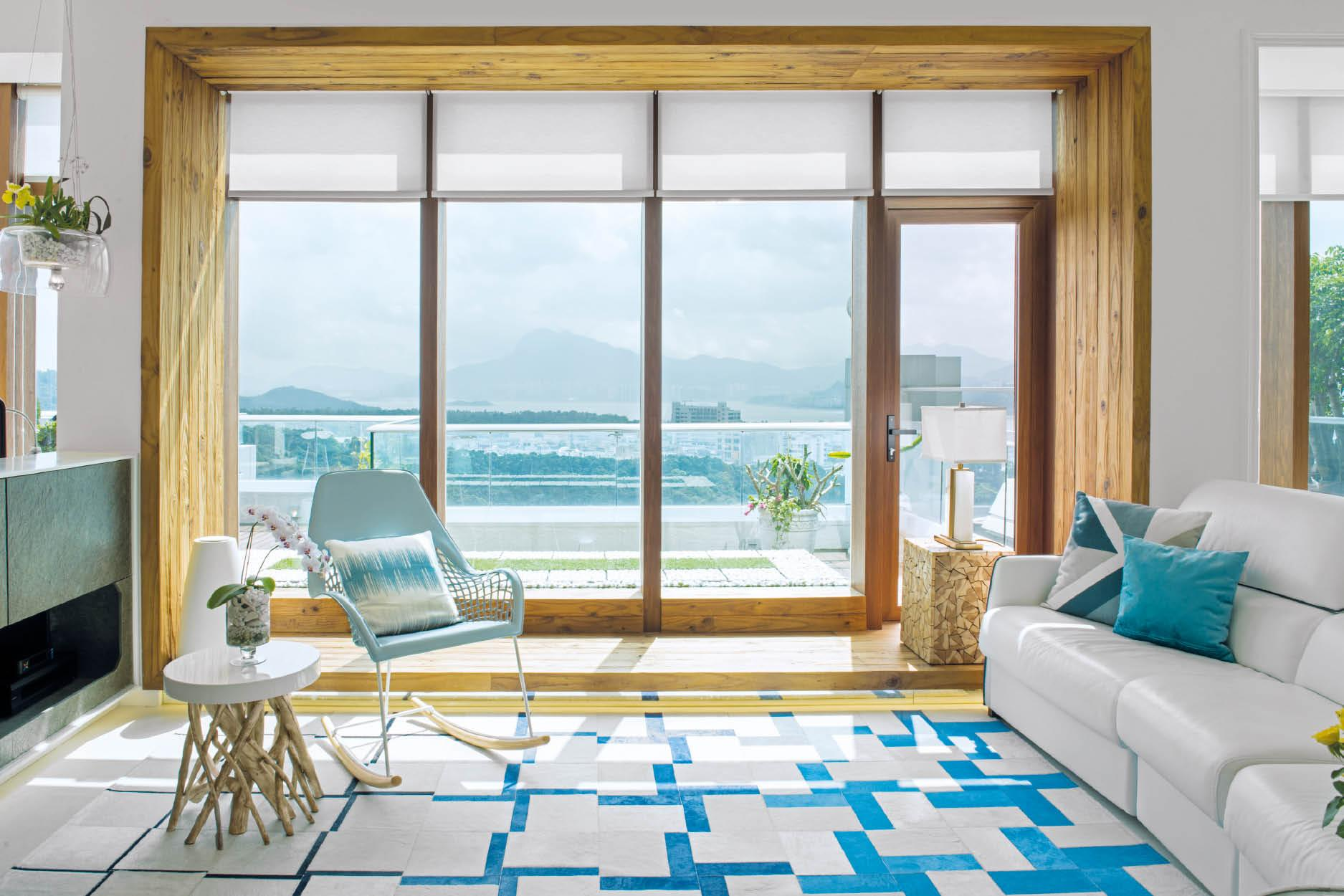 The wooden frame highlights the picturesque views outside like an artwork