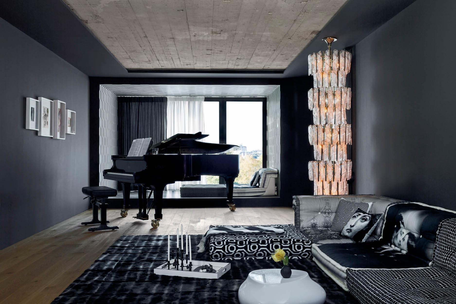 Deep window recesses allow light to flood into the consistently black-and-white-themed music room; an opulent light column made of Murano glass from Venini adds to the theatrical atmosphere