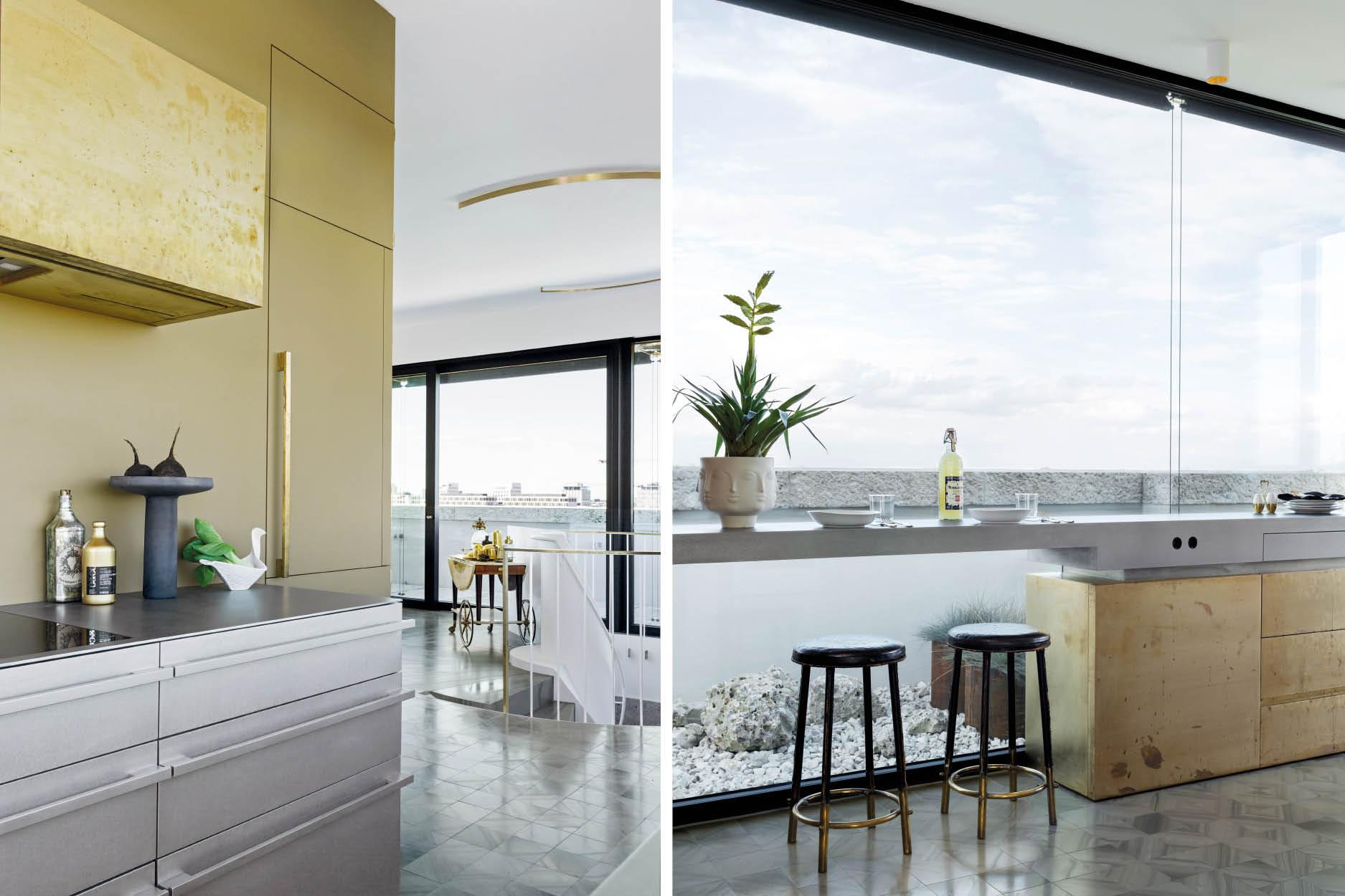 The kitchen's blend of brushed steal and untreated brass reflects the room's natural lighting. Breakfast can be enjoyed with unobstructed views of Munich