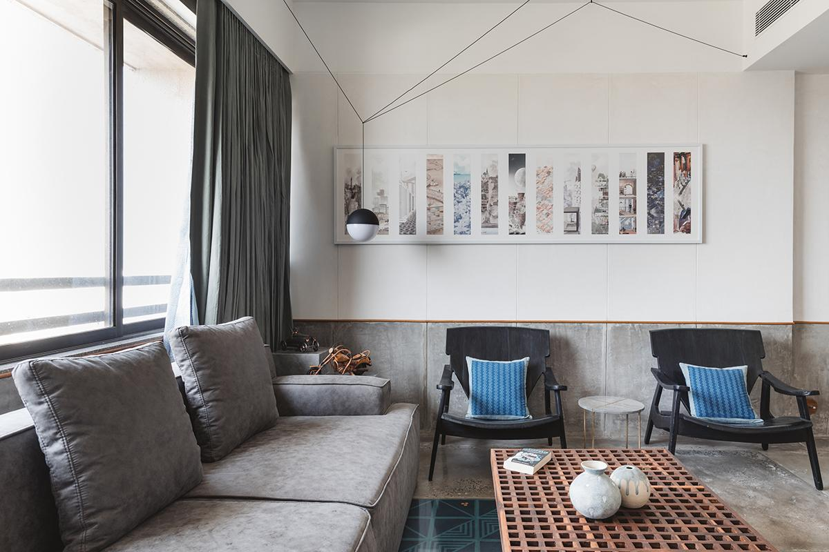 A touch of blue and teal livens up a predominantly neutral abode, replete with textures of concrete, wood and brass. (Photo: The Fishy Project)