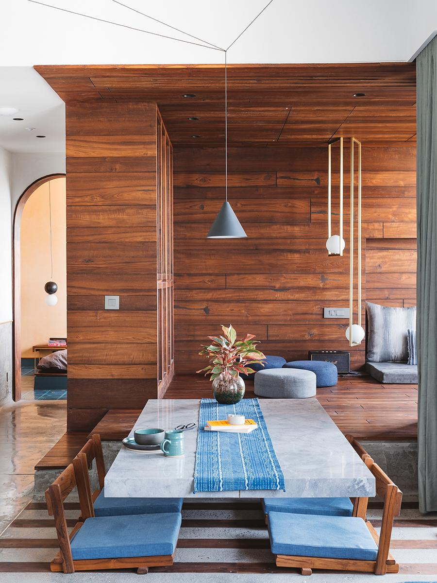 The dining area features a low-level marble dining table. (Photo: The Fishy Project)