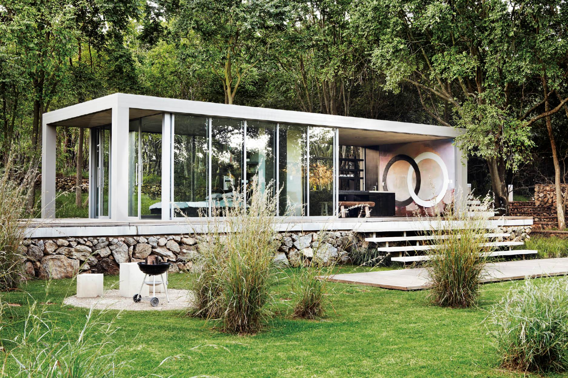 Inside a Modernist-inspired Glass Box Home in the Woods
